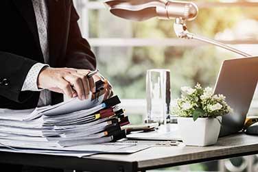 businessman-going-through-documents