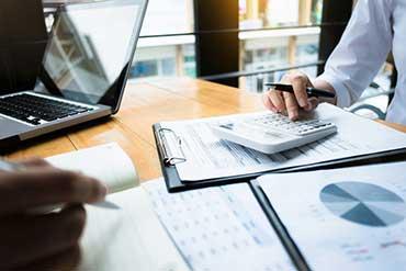 businessman-using-calculator