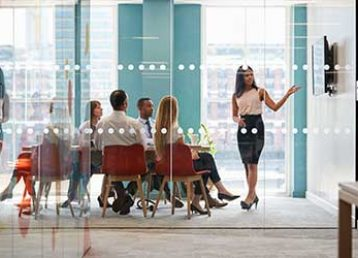 woman-presenting-in-meeting-room